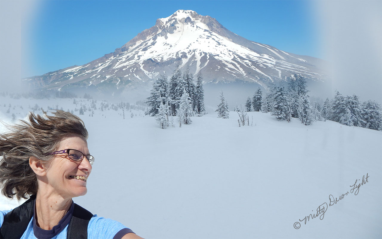 Woman with hair flying snowy Mt Hood background